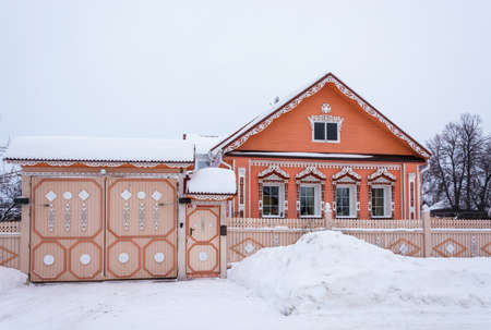 Village Vyatskoe, Yaroslavl region, Russia - February 17, 2018: Beautiful house with wooden carvings February 17, 2018 in the village of Vyatskoye, Yaroslavl region, Russia.