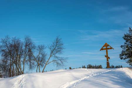 Poklonniy cross on Holy Irinarkhovo spring in a sunny winter day near the village of Khaurovo, Borisoglebsky district, Yaroslavl region, Russia.