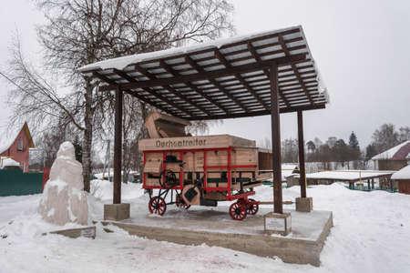 Village Vyatskoe, Yaroslavl region, Russia - February 17, 2018: An old German thresher February 17, 2018 in the village of Vyatskoye, Yaroslavl region, Russia.