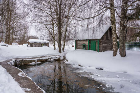 A small pond on the Holy Mother of God on a winter day in the village of Vyatskoe, Yaroslavl Region, Russia.
