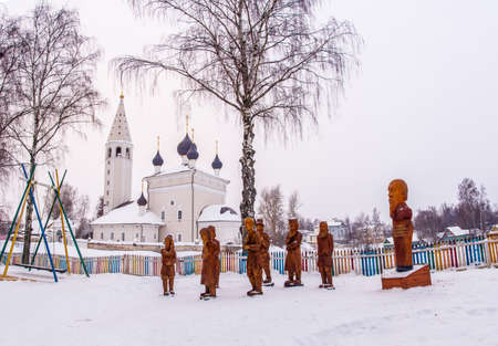 A composition of a wooden sculpture on a winter day in the village of Vyatskoe, Yaroslavl Region, Russia. Редакционное