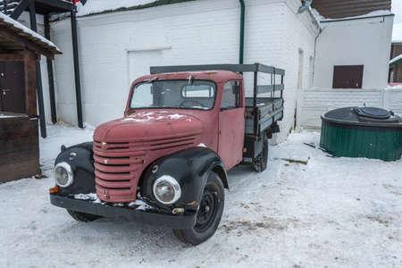 An old red truck on a winter day in the village of Vyatsky, Yaroslavl Region, Russia. Редакционное