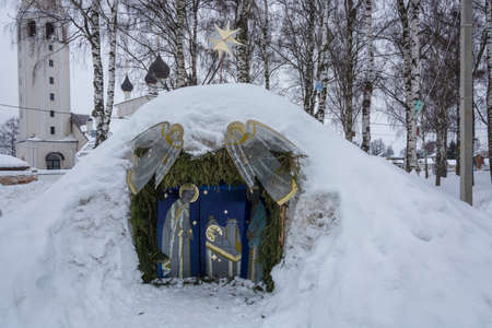 The manger of Christ, covered with snow, on the celebration of Christmas in the village of Vyatka, Yaroslavl region, Russia.
