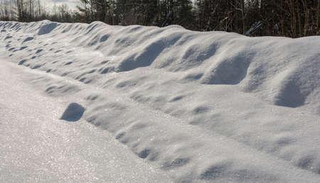 Bright texture of brilliant white snow on a winter sunny day.