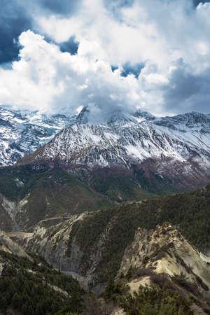 Beautiful snowy mountain peaks and clouds in the Himalayas, Nepal. Фото со стока