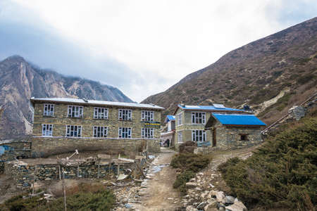 Mountain village of Yak Kharkiv in the Himalayas, Nepal-05042018: two-Storey guest houses April 5, 2018 in the mountain village of Yak Kharka in the Himalayas, Nepal. Фото со стока