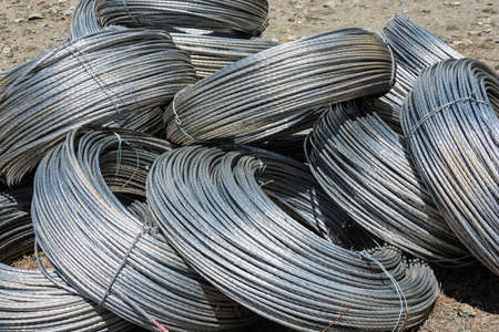 The texture of large skeins of aluminum wire shiny in the sun.