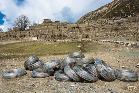 Large skeins of aluminum wire near a mountain village in the Himalayas, Nepal. Фото со стока
