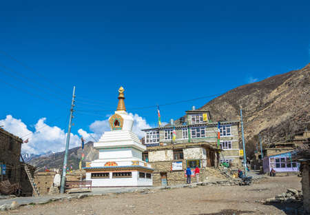 Manang village in the Himalayas, Nepal-05042018: Great white stone Buddhist stupa April 5, 2018 in the mountain village of Manang in the Himalayas, Nepal.