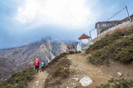 Track around Annapurna, Nepal-05042018: Two tourists on a mountain trail April 5, 2018 on a track around Annapurna, Nepal.