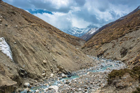 Beautiful stone river in the Himalayas on a spring Sunny day, Nepal.Beautiful stone river in the Himalayas on a spring Sunny day, Nepal. Фото со стока