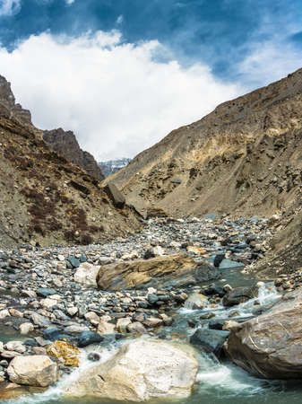 Beautiful stone river in the Himalayas on a spring Sunny day, Nepal. Фото со стока