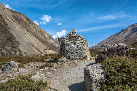 Mountain trail among the big stones in the Himalayas on a spring Sunny day, Nepal.