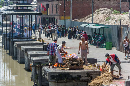 Kathmandu, Nepal - 04132018 Cremation of bodies on the banks of the Bagmati river in the Pashupatinath Temple 13 April 2018, Kathmandu, Nepal. Editorial
