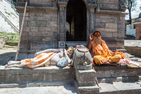 Kathmandu, Nepal - 04042018: Two sadhus in the temple complex Pesonalised 13 April 2018, Kathmandu, Nepal.