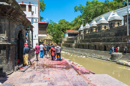 Kathmandu, Nepal - 04042018: Burial ceremony on the banks of the Bagmati river in the Pashupatinath Temple 13 April 2018, Kathmandu, Nepal.