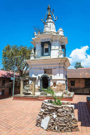 Ancient Buddhist white temple in the complex Pashupatinath Temple on a Sunny day, Nepal. Stock Photo - 106570667