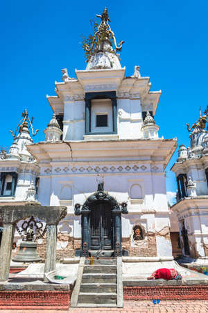 Ancient Buddhist white temple in the complex Pashupatinath Temple on a Sunny day, Nepal.