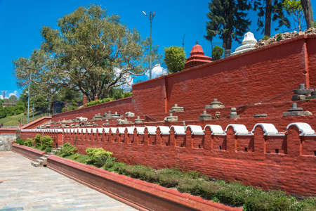Red wall in the complex Pashupatinath Temple on a clear Sunny day, Nepal. Stock Photo - 106570640