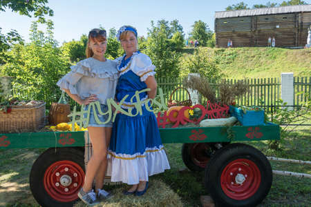Luh, Ivanovo region, Russia - 08.25.2018: Two girls are photographed for memory at the regional festival-fair Luk-luchok August 25, 2018 in the city of Luh, Ivanovo region, Russia. Redakční