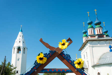 Luh, Ivanovo region, Russia - 08252018: Three bright sunflowers on the top of the trading place at the regional festival-fair Luk-luchok August 25, 2018 in the city of Luh, Ivanovo region, Russia.