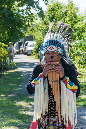 Luh, Ivanovo region, Russia - 08252018: Indian musician at the regional festival-fair Luk-luchok August 25, 2018 in the city of Luh, Ivanovo region, Russia. Redakční