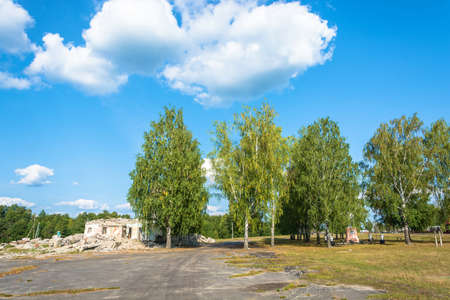 Ruins of a large stone building in the center of Pervomayka village, Kostroma region, Russia.