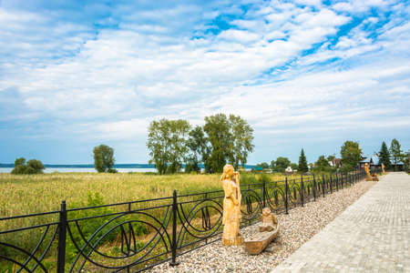 Galich, Kostroma Region, Russia - 09112018: Wooden sculptures on the embankment of Galichsky Lake September 11, 2018, Galich, Kostroma Region, Russia. Редакционное