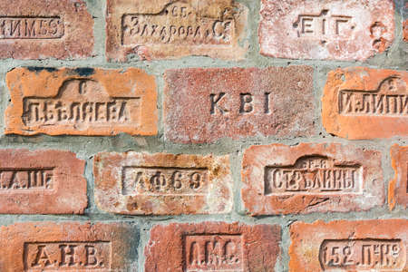 Red bricks from different manufacturers in Tsarist Russia. Shot close up. 写真素材