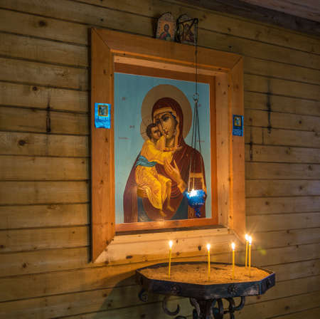 In the chapel on the holy spring in honor of the Theodore Icon of the Mother of God on an autumn day near the village of Zavetluzhie, Vokhomsky District, Kostroma Region, Russia.