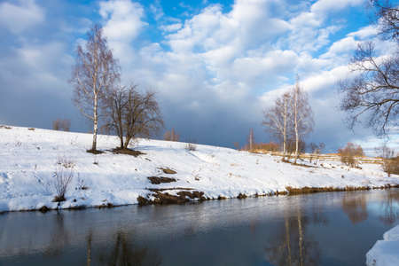 Beautiful March landscape with a small quiet river. Stok Fotoğraf