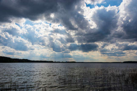 Beautiful spring landscape on the Holy Lake on a cloudy day, Ivanovo region, Russia. Stok Fotoğraf