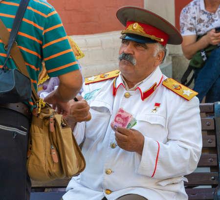 Moscow, Russia - 06222019: A man like Joseph Stalin on Nikolskaya Street. 에디토리얼