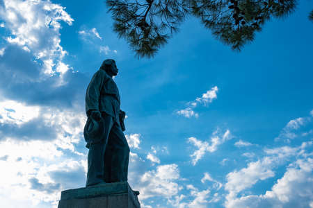 Monument to Soviet writer Maxim Gorky against a cloudy sky in Yalta, Crimea.