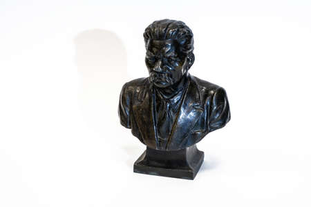 Small metal antique bust of the Soviet writer Maxim Gorky on a white background.