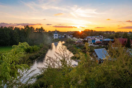 Beautiful orange sunset in the ancient Russian city of Suzdal, Russia. Фото со стока