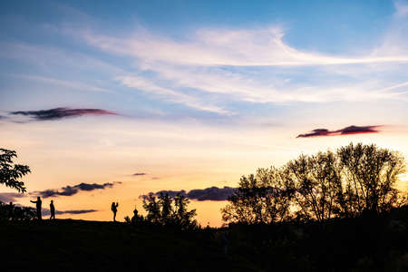 Silhouettes of people, trees and domes of churches on a beautiful sunset sky in the city of Suzdal, Russia. Фото со стока