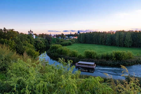 River tram on the Kamenka River in the ancient city of Suzdal, Russia. Фото со стока
