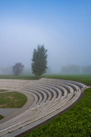 Amphitheater in the early foggy morning in the ancient city of Suzdal, Russia. Фото со стока