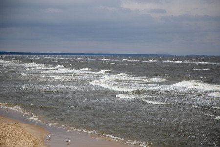The Baltic Sea Zempin beach with waves and overcast sky