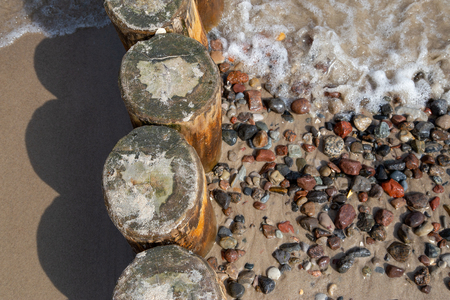 Buhnen with washed stones on the beach of the Baltic Sea in the seaside resort Zempin on Usedom