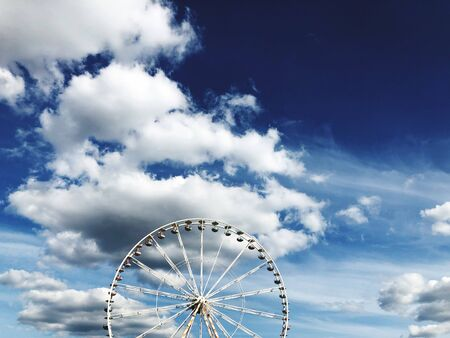 A Ferris wheel in front of a blue sky