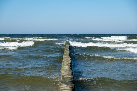 View to the Baltic Sea with its groynes at the beach of Zempin.