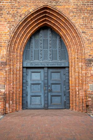 the old church door of St. Peter's Church in Wolgast at the baltic sea