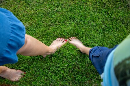 Naked feet and toes in fresh green grass, a great feeling.