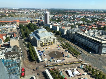The view of Leipzig with the famous opera, the Augustusplatz and in the background the main station with blue sky on a sunny day. Reklamní fotografie