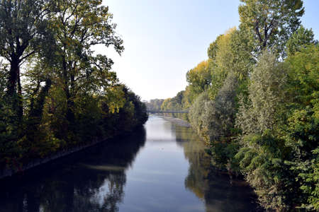 The Dora River in Turin with trees on the shores Stock Photo