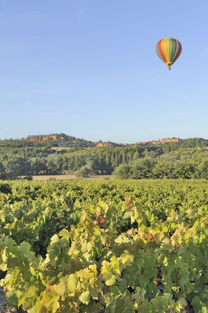 Hot air balloon flying over Roussillon, Provence, France in early morning Stock Photo - 8110558