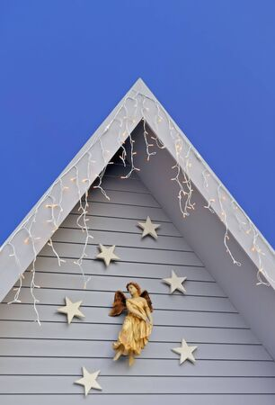 angel, stars and lights on wooden house against twilight sky background Stock Photo - 8178724