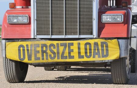 oversize: Closeup of oversize load sign on front of truck